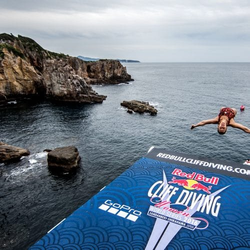 Lysanne Richard of Canada performs from the 21.5 metre platform during the first training session for the eighth stop of the Red Bull Cliff Diving World Series in Shirahama, Japan on October 14, 2016. // Dean Treml/Red Bull Content Pool